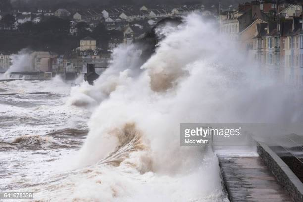 powerful waves engulf rainway line at dawlish during storm - retaining wall stock pictures, royalty-free photos & images
