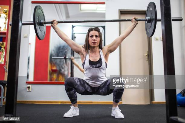 powerful woman - snatch weightlifting stock photos and pictures