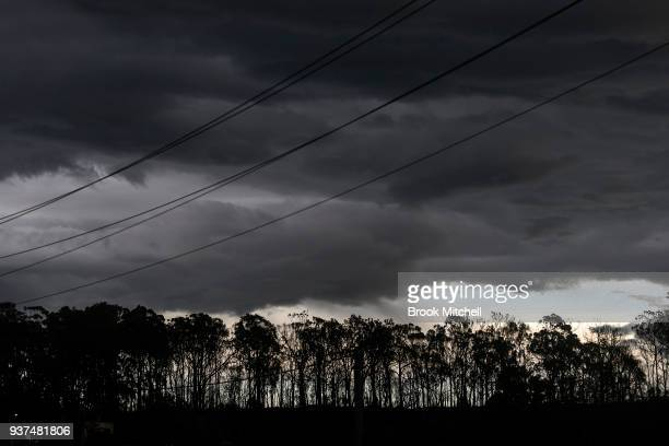 Powerlines and burnt trees along the ridgeline behind Tathra are pictured on March 25 2018 in Tathra Australia A bushfire which started on 18 March...