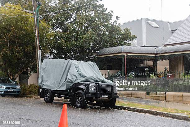 Powerlines fallen across a car during wild weather in Bronte on June 5 2016 in Sydney Australia The Bureau of Meteorology is forecasting up to 300mm...