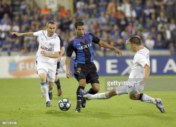Poznan's Seweryn Gancarczyk and Ivan Djurdjevic and Brugge's Nabil Dirar in action during the return leg match Club Brugge vs Lech Poznan in the play...