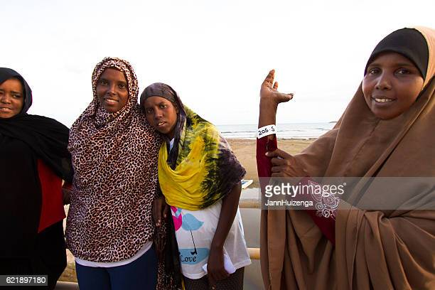 pozzallo, sicily: just-arrived somali migrant shows her id wristband - somali woman stock photos and pictures