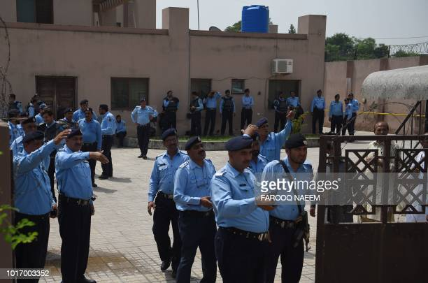 PPakistani policemen gather at the corruption court building during the case hearing of jailed former Pakistani Prime Minister Nawaz Sharif in...