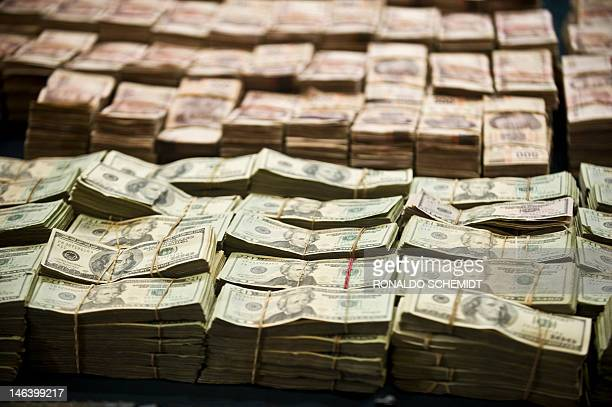 Pparcial view of more than 1 Million Dollars and more than 41 Million Mexican pesos seized to the alleged member of Zetas drug cartel Eric Jovan...