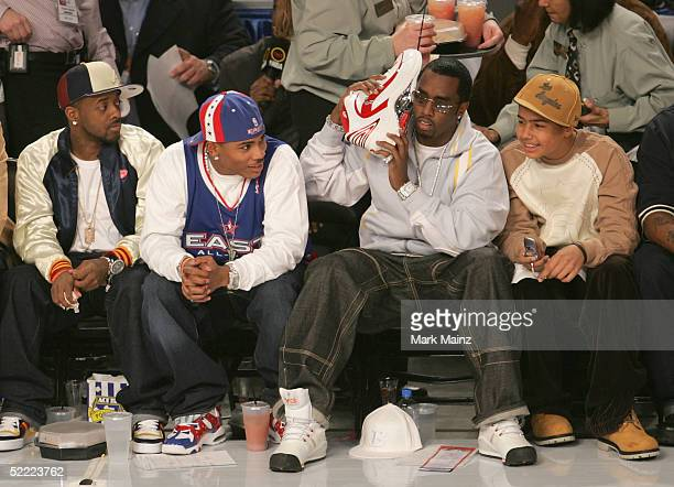 Pproducer Jermaine Dupri rapper Nelly and Sean 'P Diddy' Combs attend the 2005 NBA All Star Game at the Pepsi Center on February 20 2005 in Denver...