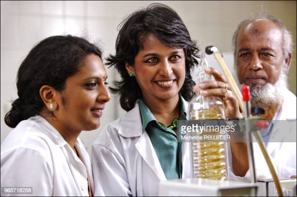 Pr Ameenah GuribFakin with Ouma and Kader concentrating plants extracts with rotary evaporator in the lab at the University of Mauritius Ameenah...