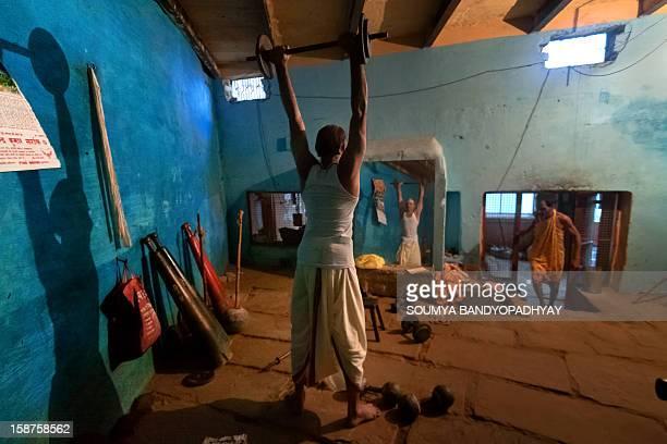 Practice at an old akhara in benaras. Who: a 'pahelwan' what: practice session at an old 'akhara' where: varanasi, uttar pradesh, india when:...