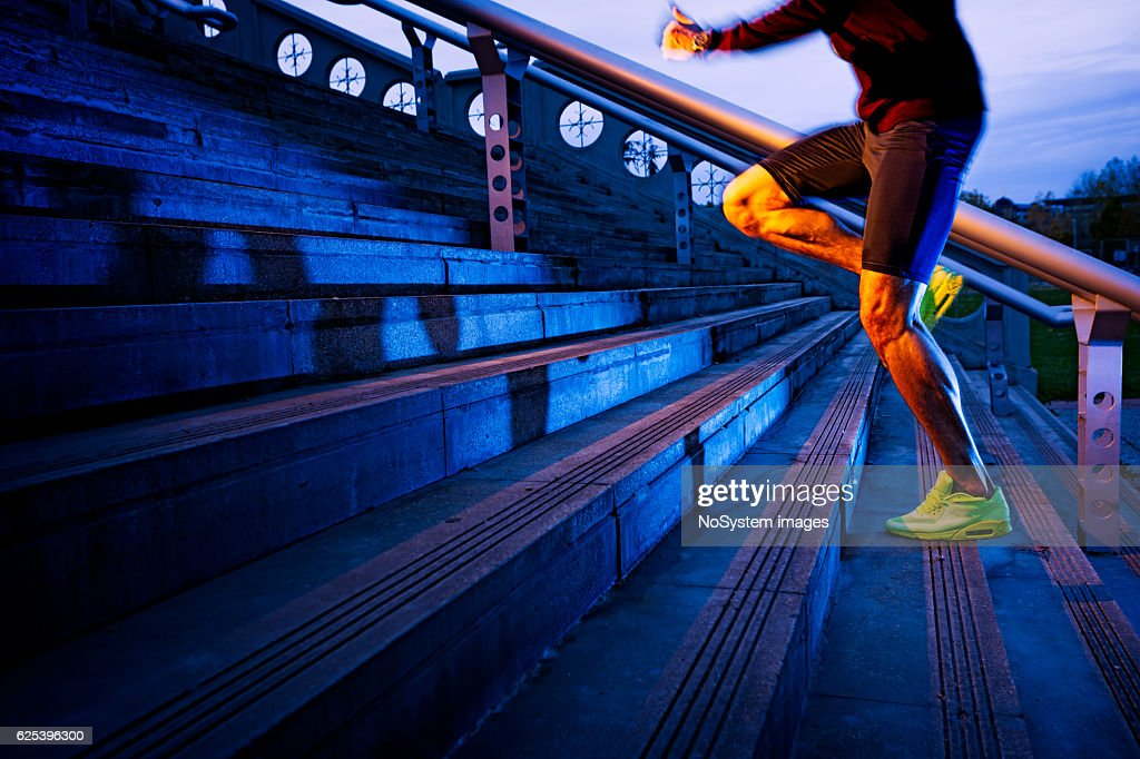 Practice, close up of young man running up the stairs : Stock Photo