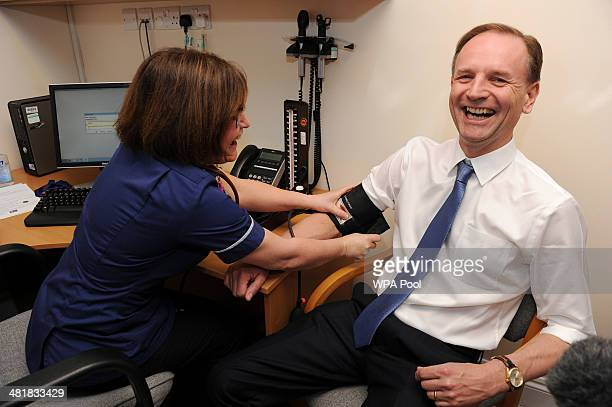 Practice Nurse Lesley Dobson takes the blood pressure of the new chief executive of NHS Simon Stevens at Consett Medical Centre in County Durham on...