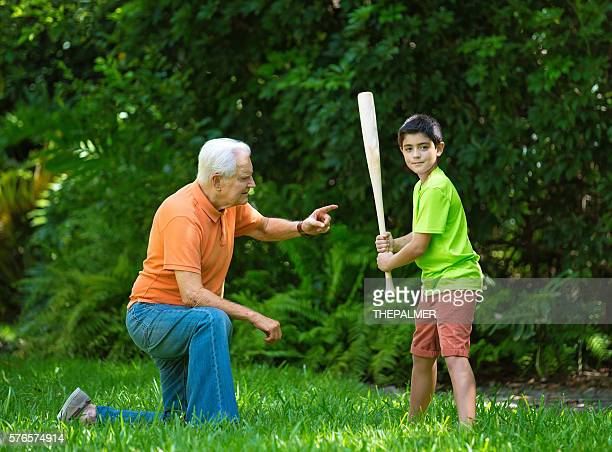 practice session with grandpa - batting sports activity stock pictures, royalty-free photos & images