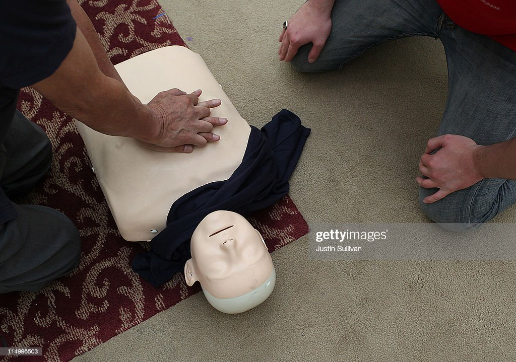 A practices CPR compressions on a mannequin at San Francisco City Hall on June 1, 2011 in San Francisco, California. The San Francisco Paramedic Association and the American Heart Association kicked off National CPR Week by offering free CPR training to the public.