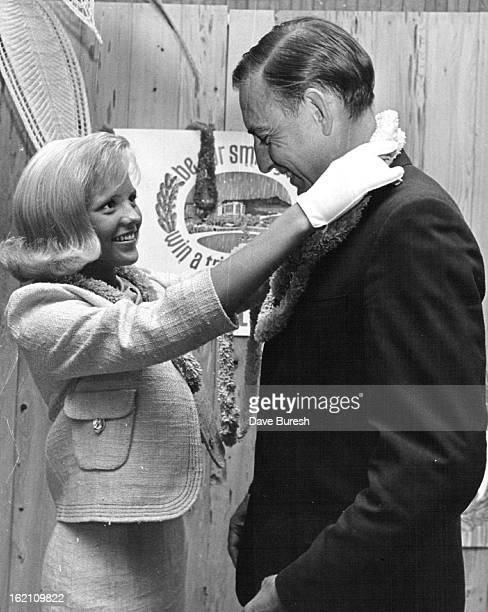 JUL 2 1965 JUL 6 1965 Practicing a Welcome Tia Tyler Colorado 1965 Jantzen Smile Girl places a lei on Paul Felix vice president of Denver Dry Goods...