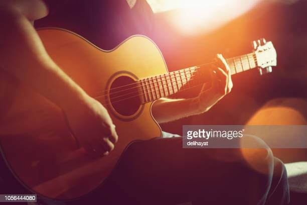 practicing acoustic guitar - acoustic guitar stock pictures, royalty-free photos & images