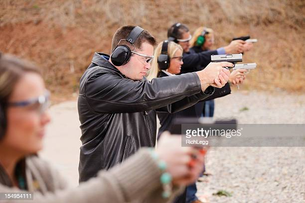 practicing at the shooting range - pistol stock pictures, royalty-free photos & images