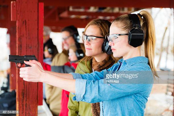 practicing at the shooting range - handgun stock pictures, royalty-free photos & images