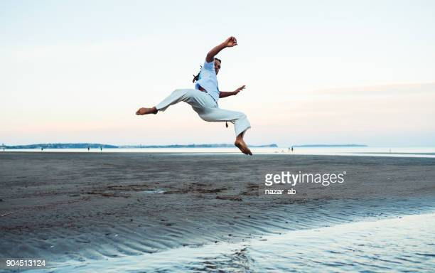 Practicing Capoeira.