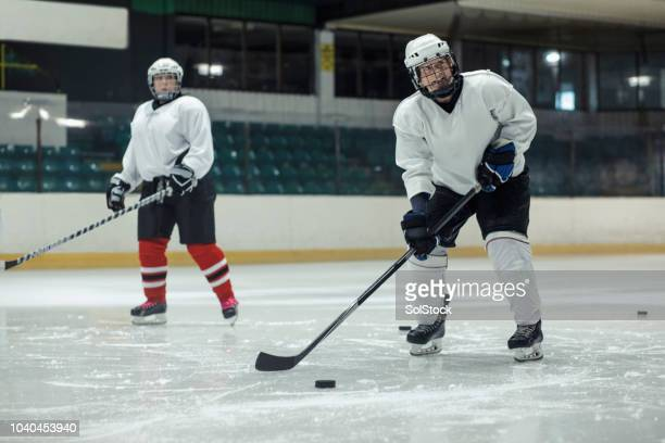 practicing control of the hockey puck - puck stock pictures, royalty-free photos & images