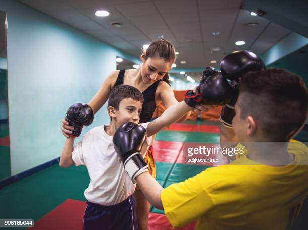 practicing in the boxing hall - muay thai stock pictures, royalty-free photos & images