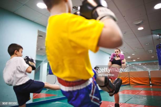practicing in the boxing hall - muay thai imagens e fotografias de stock