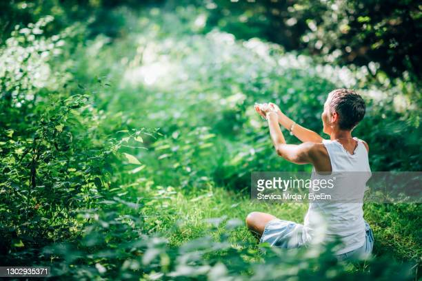 practicing mindfulness for gratitude and fulfillment, feeling connected with nature - one mature woman only stock pictures, royalty-free photos & images