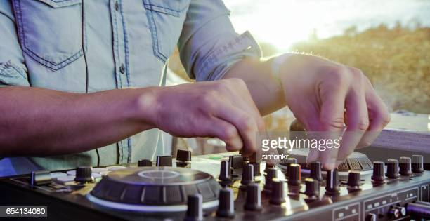 dj practicing on sound mixer - turning stock photos and pictures