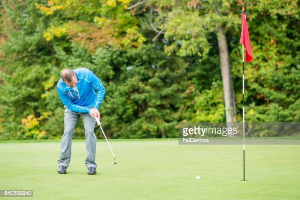 practicing putting - golf flag stock photos and pictures
