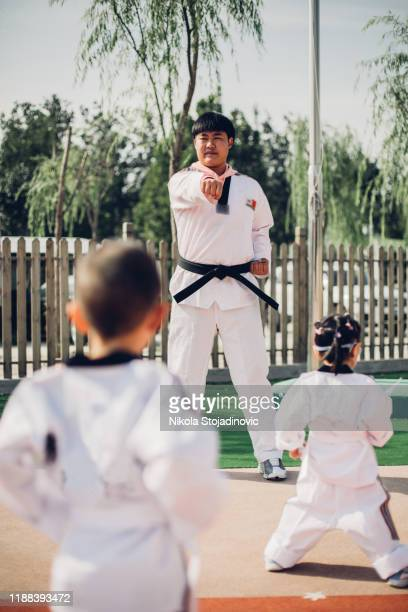 practicing taekwondo and warming up for treining - boxing belt stock pictures, royalty-free photos & images