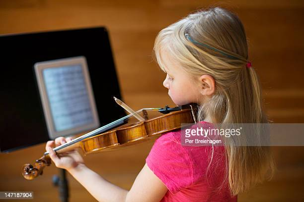 practicing violin with a tablet computer