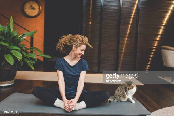 practicing yoga at home - good posture stock pictures, royalty-free photos & images