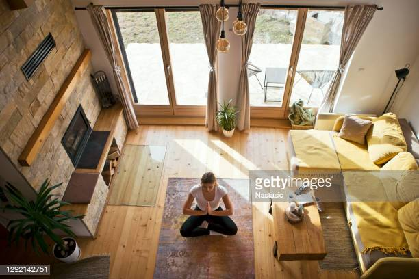 practicing yoga in positive environment - serbia stock pictures, royalty-free photos & images