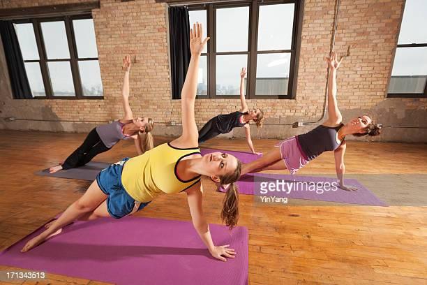 Practing Yoga Side Plank Pose in Health Club Training Hz