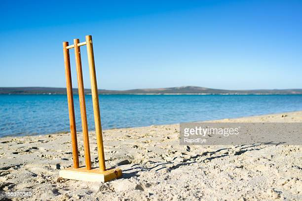 practise cricket stumps on beach beside beautiful blue lagoon - beach cricket stock pictures, royalty-free photos & images