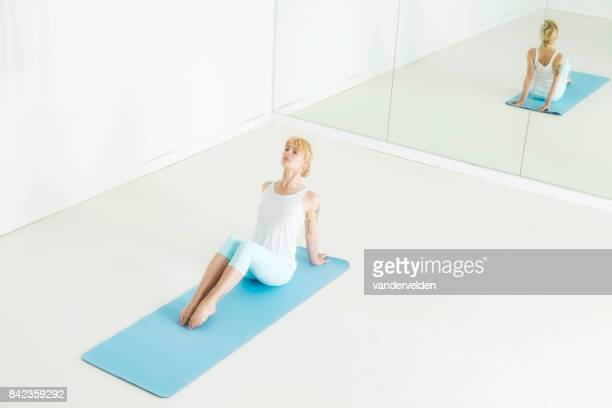 practising yoga - full length mirror stock photos and pictures