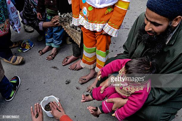 Practitioners give leech therapy to Kashmiri children on March 21 in Srinagar the summer capital of Indian administered Kashmir India Nowruz the...
