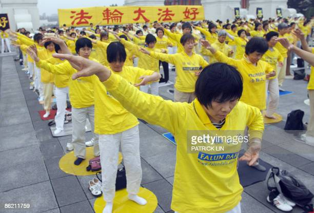 Practitioners of the Falungong spiritual movement gather in Taipei on April 25 2009 to mark the 10th anniversary of the Chinese government ban The...