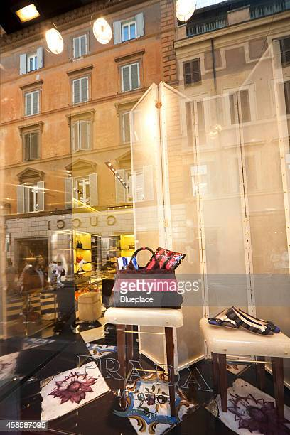 prada, shop window in rome, italy. - gucci dress stock pictures, royalty-free photos & images