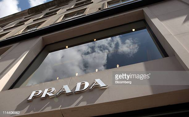 Prada SpA sign hangs above the company's boutique on Old Bond Street in London, U.K., on Thursday, May 19, 2011. Prada SpA, the Italian producer of...