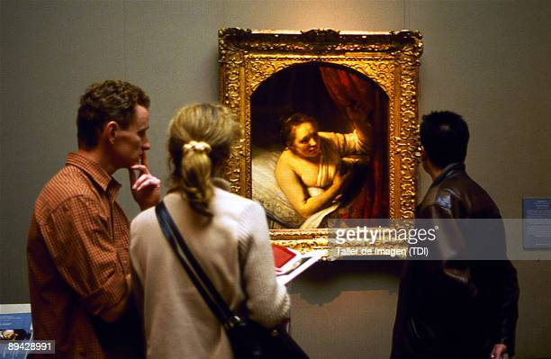 Prado Museum in Madrid Turist and visitors looking the painting 'A woman in bed' by Rembrandt Photo by Taller de Imagen /Cover/Getty Images