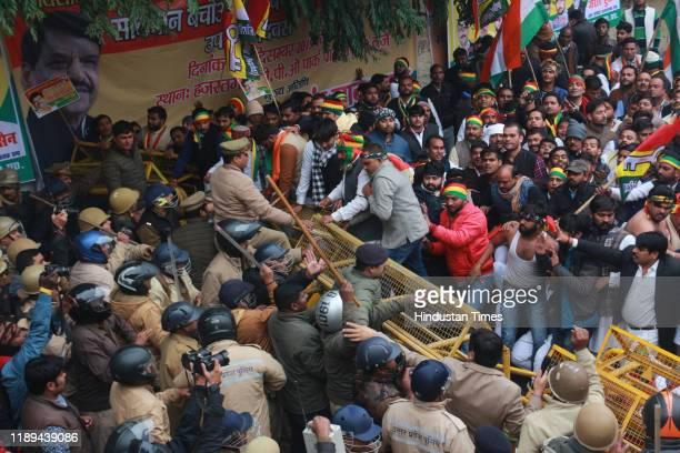 Pragatisheel Samajwadi Party workers are met with police barricading and an eventual lathi charge while demonstrating outside the party office to...