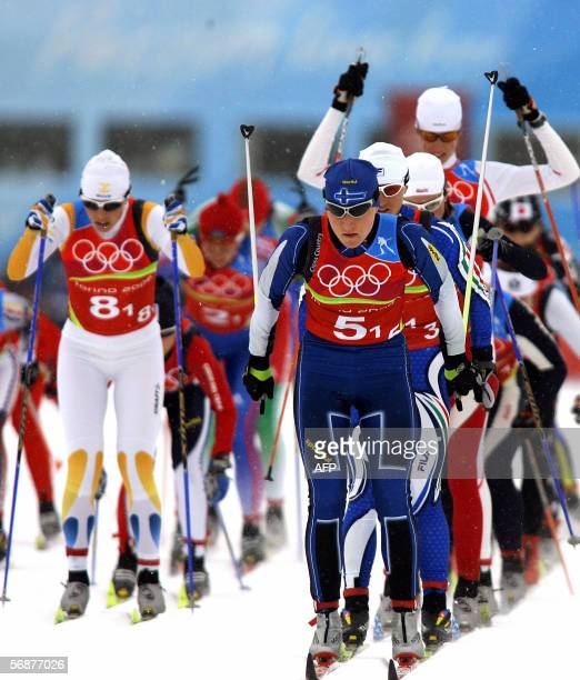 Aino Kaisa Saarinen of Finland leads other athletes during the women 4x5 km relay of the 2006 Winter Olympics' cross country in Pragelato, 18...