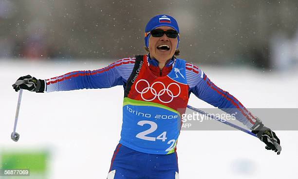 Evgenia Medvedeva-Abruzova of Russia reacts at the finish line of the women 4x5 km relay of the 2006 Winter Olympics' cross country in Pragelato, 18...