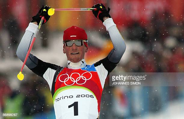 German Georg Hettich reacts as he crosses the finish line of the 2006 Winter Olympics' Nordic Combined 7.5 km sprint in Pragelato, 21 February 2006....