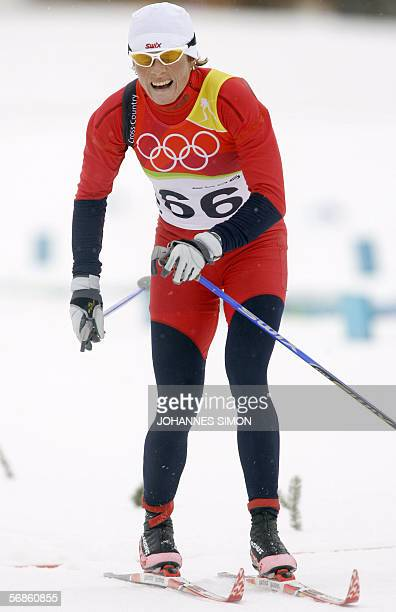 Hilde G. Pedersen of Norway crosses the finish line of the women's 10km classical of the 2006 Winter Olympics' cross country event in Pragelato, 16...