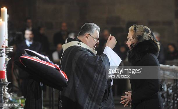 Prague Archbishop Dominik Duka gives the communion to Havel's widow Dagmar Havlova during the funeral mass of former Czech President Vaclav Havel in...