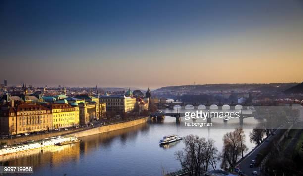 prague at sunset - vltava river stock photos and pictures