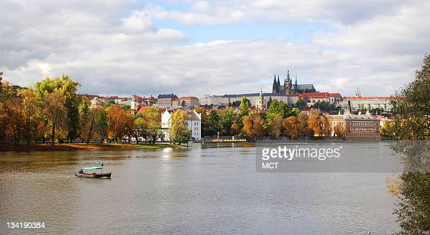 Prague Castle and the Vltava River can be seen in an autumn background