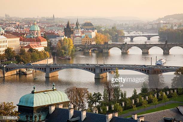 prague cityscape with the vltava river and its bridges at sunset 2007. - prag stock-fotos und bilder
