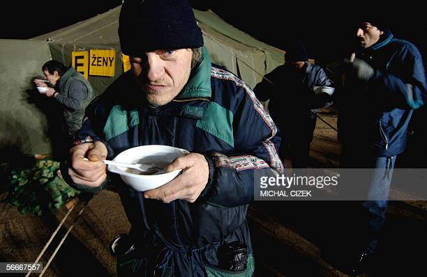 A group of homeless have dinner in front of a camp for homeless people at Prague Letna 25 January 2006 Five heated army tents for about 100 homeless...