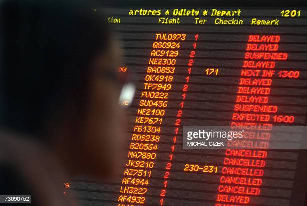 Prague, CZECH REPUBLIC: A tourist looks at the information board full of cancelled flights at Ruzyne airport, 24 January 2007.Heavy snowfall hit all...