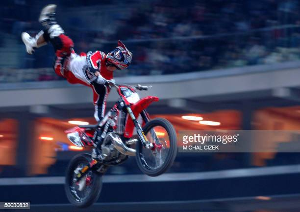An unidentified freestyle biker with face hidden performs in Sazka Arena during the Monster Jam freestyle motocross extrem tour event 29 October 2005...